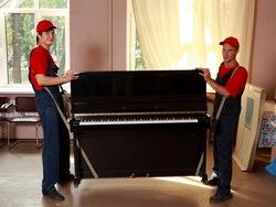 Переноска пианино на ремнях